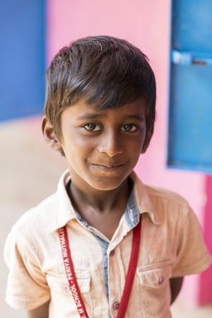 PONDICHERY, PUDUCHERY, INDIA - SEPTEMBER 04, 2017. Unidentified child at schhol behind the window