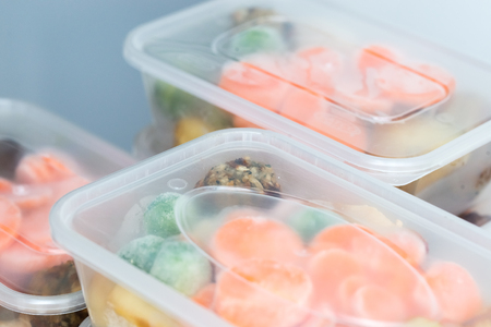 Foto de Meal prep. Close up of home made roast chicken dinners in containers ready to be frozen for later use. - Imagen libre de derechos