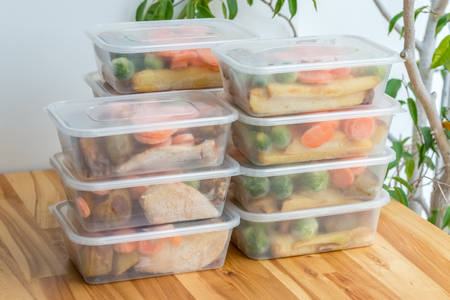 Foto de Meal prep. Stack of home cooked roast chicken dinners in containers ready to be frozen for later use. - Imagen libre de derechos