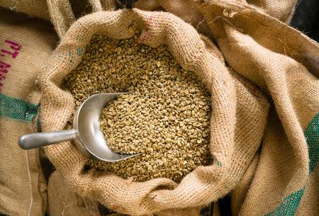 Foto de Big sack of coffee beans waiting to be roasted in coffee roaster warehouse - Imagen libre de derechos