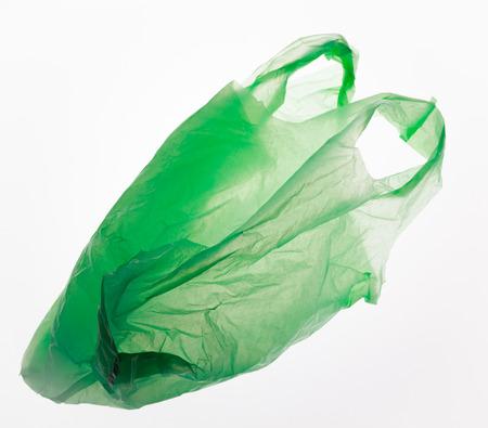 Foto de Green plastic bag isolated on white. - Imagen libre de derechos