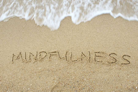 Photo for Mindfulness written on sand - Royalty Free Image