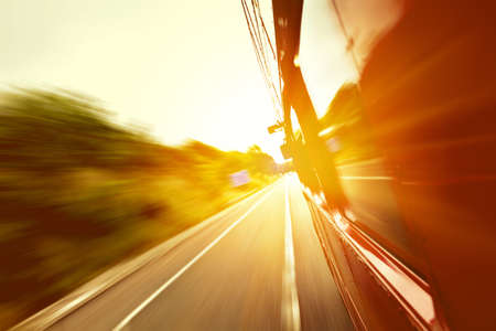 Photo pour Red old bus going fast on the highway with motion blur background - image libre de droit