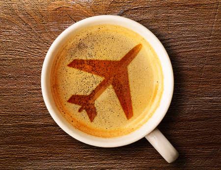 Foto de airport coffee cup  fresh espresso on table, view from above - Imagen libre de derechos