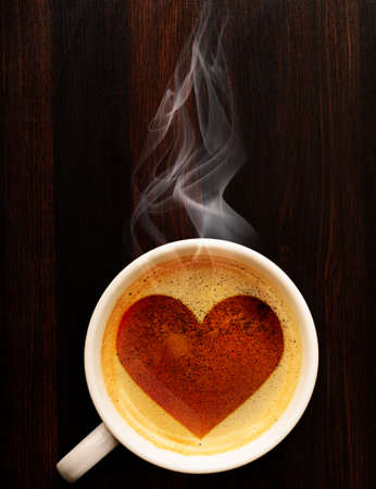 Photo pour loving coffee  cup of fresh espresso with heart sign, view from above - image libre de droit