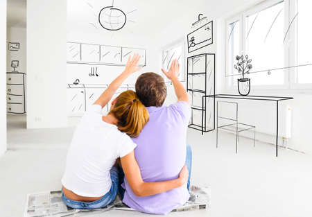 Foto de couple at their new empty apartment - Imagen libre de derechos