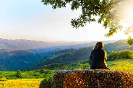 Foto de scenic view of woman watching at sunset mountains, Peneda-Geres National Park, northern Portugal. - Imagen libre de derechos