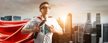 Photo for Business superhero. Young businessman showing super hero suit under his shirt down town on sunset. - Royalty Free Image