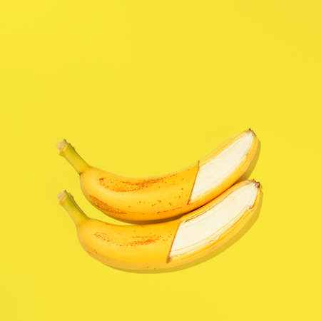Photo pour Fresh bananas on yellow background, view from above - image libre de droit