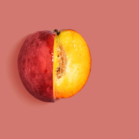 Photo pour Fresh nectarine on red background, view from above - image libre de droit