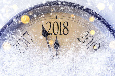 Foto de Countdown to midnight. Retro style clock counting last moments before Christmas or New Year 2018. - Imagen libre de derechos