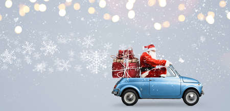 Photo pour Santa Claus on car delivering Christmas or New Year gifts at snowy gray background - image libre de droit