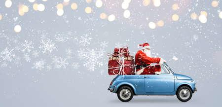 Foto de Santa Claus on car delivering Christmas or New Year gifts at snowy gray background - Imagen libre de derechos