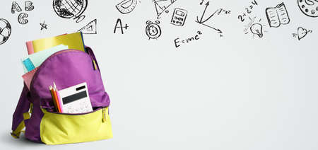 Foto de Back to school shopping backpack. Accessories in student bag against chalkboard - Imagen libre de derechos