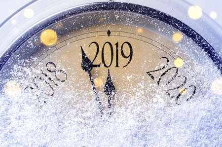 Foto de Countdown to midnight. Retro style clock counting last moments before Christmass or New Year 2019. - Imagen libre de derechos