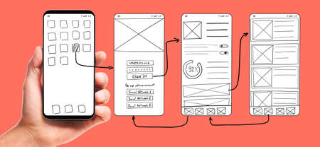 Foto de UI development. Male hand holding smartphone with wireframed user interface screen prototypes of a mobile application on living coral background. - Imagen libre de derechos