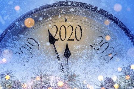 Foto de Countdown to midnight. Retro style clock counting last moments before Christmass or New Year 2020. - Imagen libre de derechos