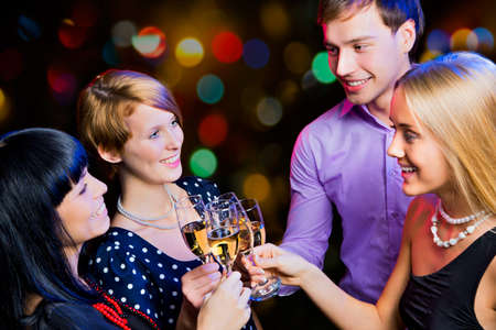Photo pour Portrait of happy friends wishing you Merry Christmas - image libre de droit