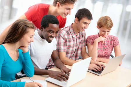 Photo for Group of young students studying together in a college - Royalty Free Image