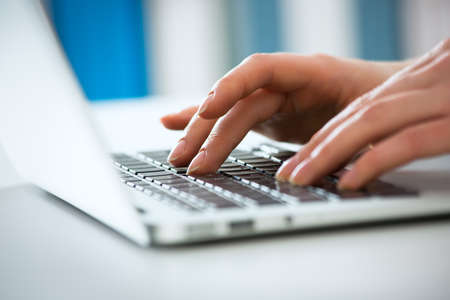 Photo for Closeup of businesswoman typing on laptop computer - Royalty Free Image