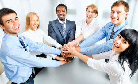 Photo pour Business team showing unity with their hands together - image libre de droit