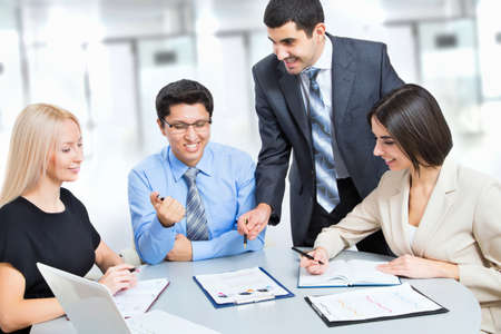 Photo for A business team of four plan work in office - Royalty Free Image
