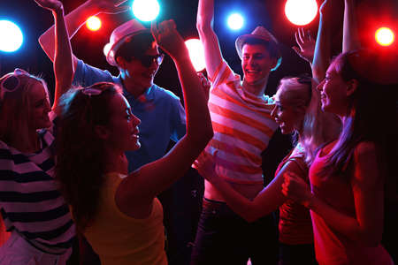 Photo pour Young people having fun dancing at party. - image libre de droit