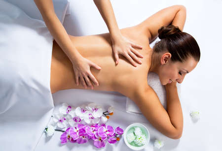 Foto de Masseur doing massage on woman face in the spa salon. Beauty treatment concept. - Imagen libre de derechos