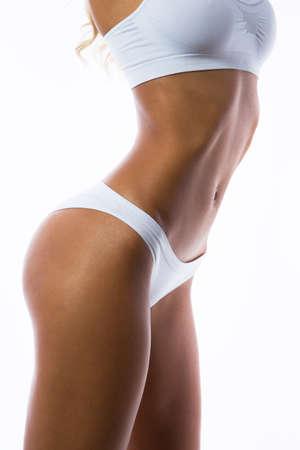 Foto de Beautiful slim body of a woman in lingerie - Imagen libre de derechos