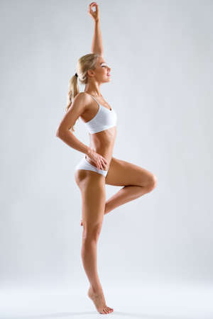 Photo for Beautiful fitness woman with a perfect body - Royalty Free Image