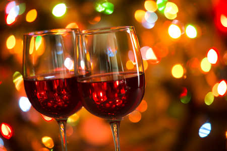 Photo for Crystal glasses of wine on the background of Christmas lights - Royalty Free Image