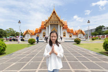 Photo for Happy smiling tourist girl,Asian cute girl with pay respect at Wat Benchamabopitr or Marble Temple is a Buddhist temple in the city of Bangkok,Thailand, summer vacation,travel concept. - Royalty Free Image