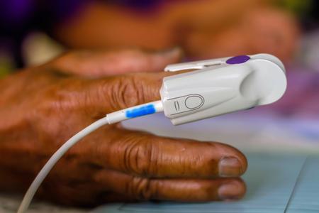 Foto de The patient with oxygen saturation sensor - Imagen libre de derechos