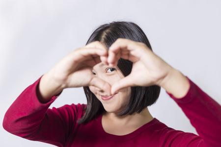Photo for Woman show heart hands - Royalty Free Image