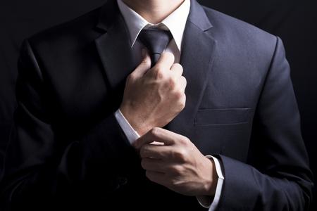Foto de Businessman Adjust Necktie his Suit - Imagen libre de derechos