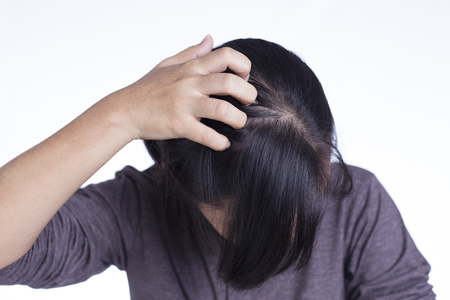 Photo pour Woman Scratching Her Head on Isolated White Background - image libre de droit