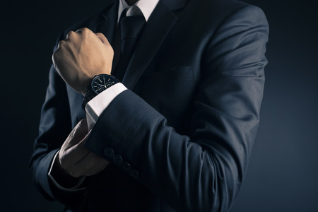 Foto de Businessman Fixing Cufflinks his Suit - Imagen libre de derechos