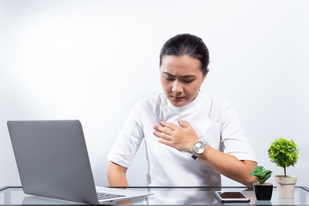 Foto für Woman has chest pain at office - Lizenzfreies Bild