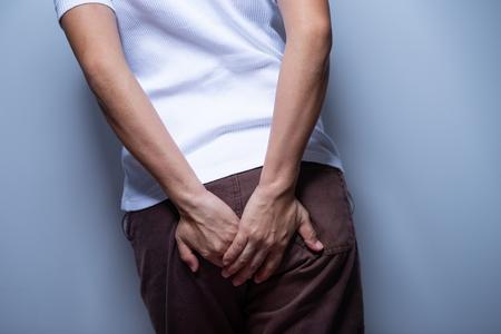 Photo pour Woman holding her bottom - image libre de droit