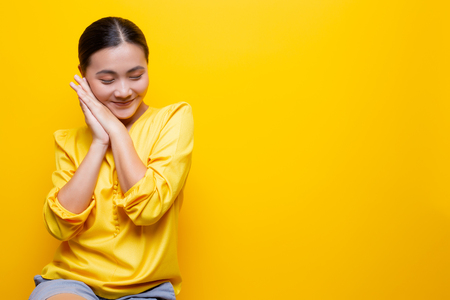 Photo for Woman feel shy standing isolated over yellow - Royalty Free Image