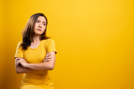 Photo for Sad woman isolated over yellow background - Royalty Free Image