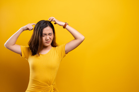 Photo for Woman scratching her head - Royalty Free Image