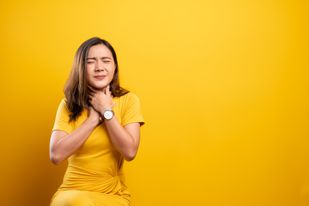 Foto für Woman has sore throat isolated over yellow background - Lizenzfreies Bild