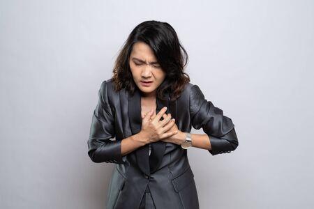 Foto für Businesswoman has chest pain isolated over white background - Lizenzfreies Bild