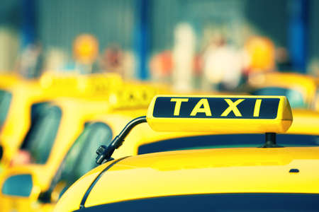 Photo for Taxi cars are waiting in row on the street - selective focus - Royalty Free Image