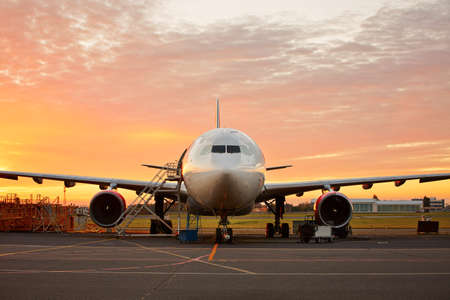 Photo for Aircraft maintenance  - large aircraft at the beautiful sunrise - Royalty Free Image