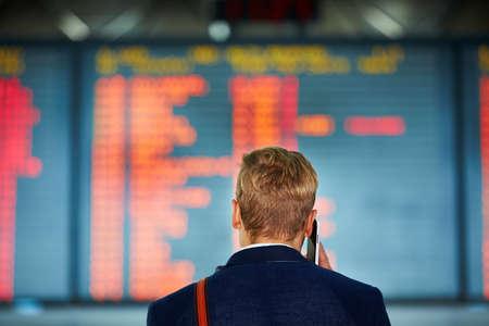 Photo pour Young businessman is waiting at the airport - image libre de droit