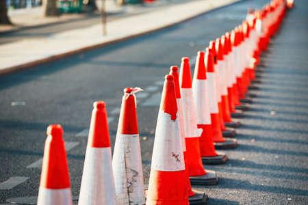 Foto de Road work. Orange traffic cones in the middle of the street.  - Imagen libre de derechos