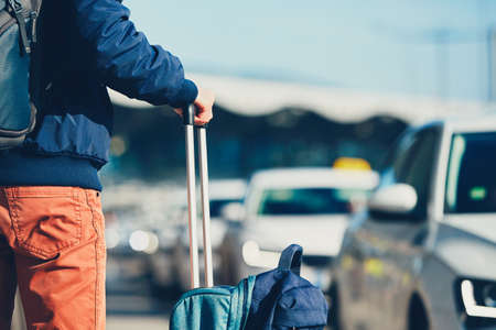 Photo pour Airport taxi. Passenger is waiting for taxi car. - image libre de droit