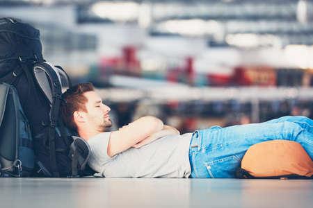 Photo pour Traveler waiting at the airport departure area for his delay flight. - image libre de droit
